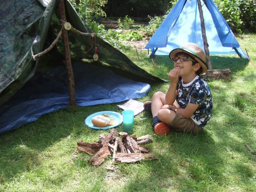boy enjoying forest school birthday party