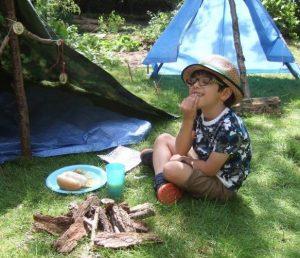 boy enjoying forest school birthday party