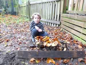making a hedgehog house at forest school