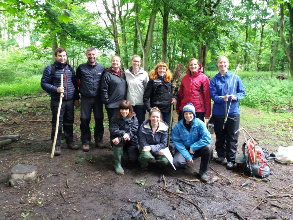 trainees in the woods at forest school
