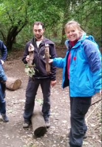 trainees with stick puppets at Forest School